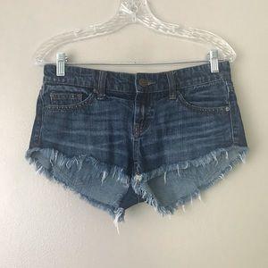 ☀️ BDG low rise Dolphin raw hem mini jean shorts